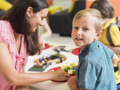 teacher-playing-with-kindergarten-kid